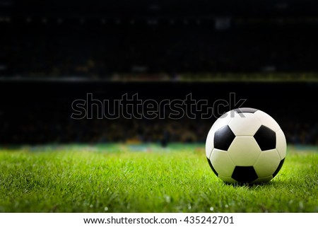 soccer field and stadium with fans the night light before the match, soccer stadium, soccer match, soccer on grass, soccer football, soccer team, soccer sport, soccer at night, soccer arena. - stock photo