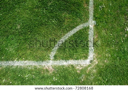 soccer field close-ups of markings on a sunny day - stock photo