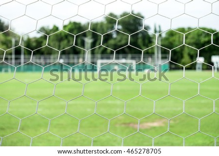 soccer field from behind goal net