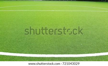 soccer field lines with green lawn