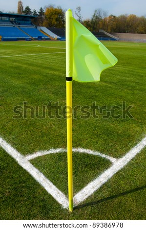 soccer field with a yellow corner flag pole. - stock photo