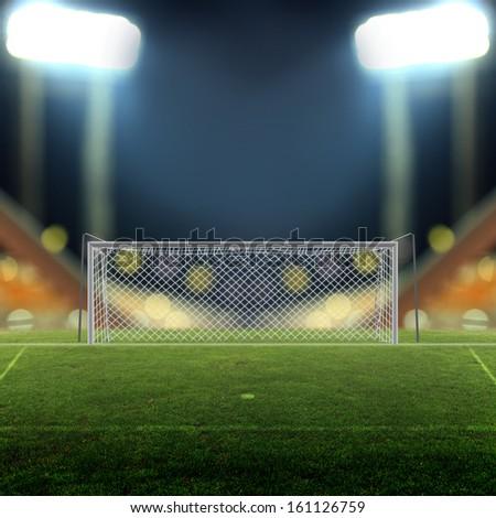 Soccer field with bright spotlights - stock photo