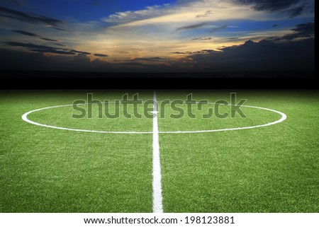 soccer field with sunset - stock photo