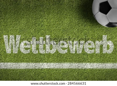 Soccer field with the text: Competition (in German)  - stock photo