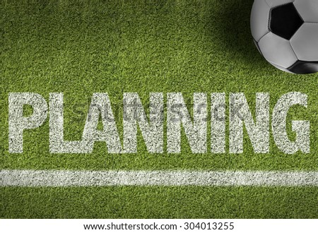 Soccer field with the text: Planning - stock photo