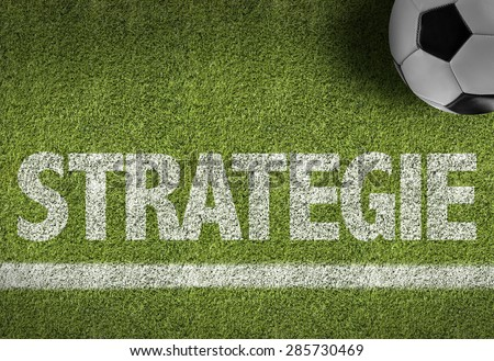 Soccer field with the text: Strategy (in English) - stock photo