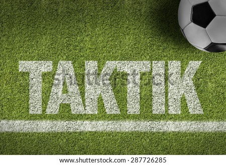 Soccer field with the text: Tactics (in German) - stock photo