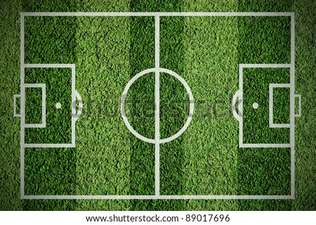 Soccer football field on the green grass - stock photo