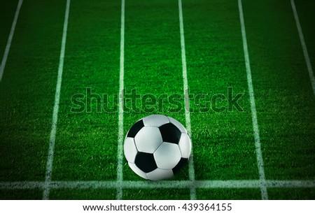 Soccer football field stadium and ball on green grass - stock photo