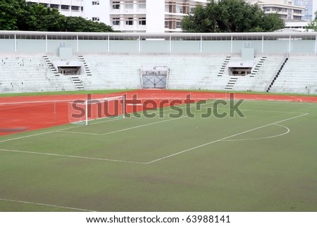 soccer football goal with penalty area on fake grass pitch - stock photo