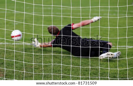 Soccer football goalkeeper making diving save - stock photo