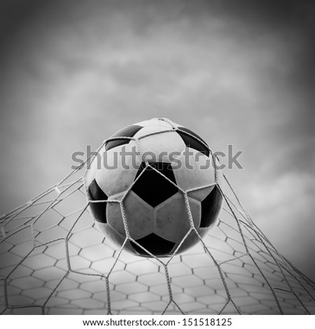 Soccer football in Goal net with the sky. For sport concept. - stock photo