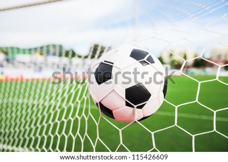soccer football in the goal net - stock photo