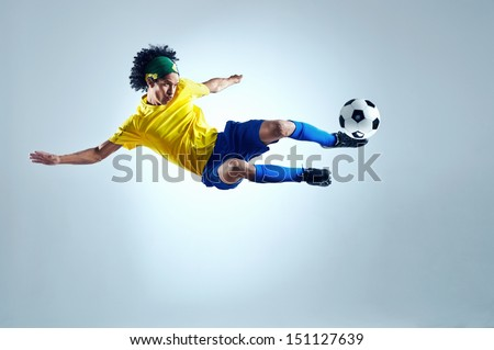 soccer football kick striker scoring goal with accurate shot for brazil team world cup - stock photo