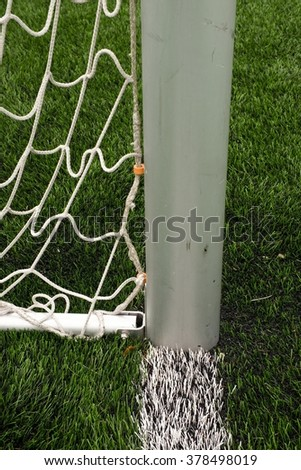soccer football net. Grass on football playground in the background