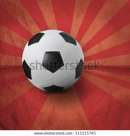 soccer football on red ray background - stock photo