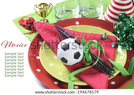 Soccer football party table in red white and green team colors. - stock photo