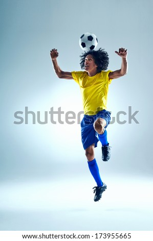 Soccer football player header ball with skill - stock photo