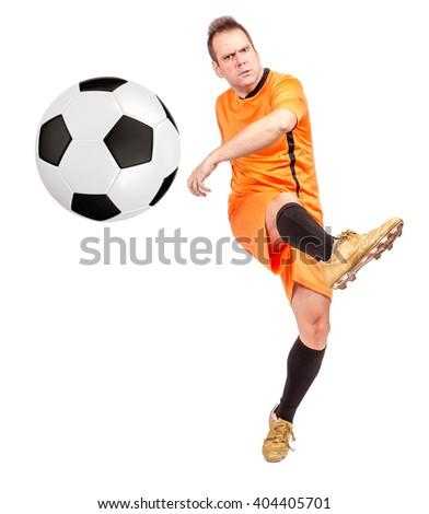 Soccer football player kicking the ball isolated on a white background. Footballer kicking the ball ahead at you. Kick to soccer ball to camera. Man playing soccer with kick ball on a white background - stock photo