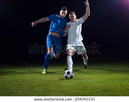 soccer football team  player game duel isolated on black background - stock photo