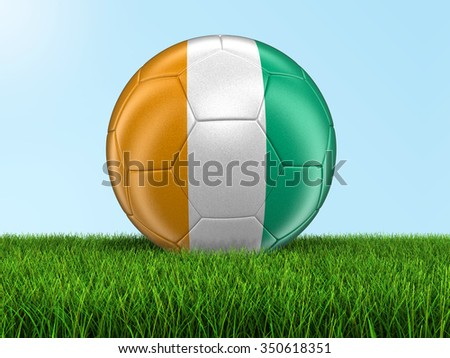 Soccer football with Cote d'ivoire flag on grass. Image with clipping path - stock photo