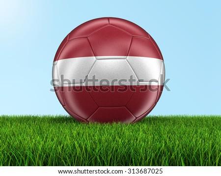 Soccer football with Latvian flag on grass - stock photo