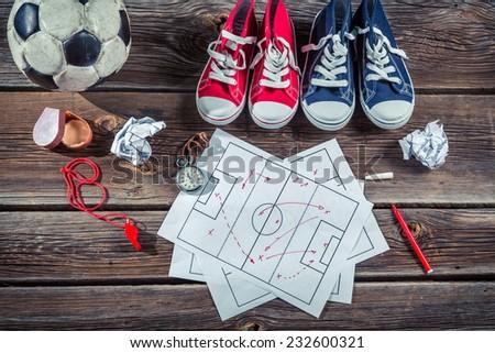 Soccer formation tactics on school desk - stock photo