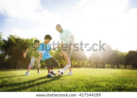 Soccer Fun Sports Family Playing Concept - stock photo