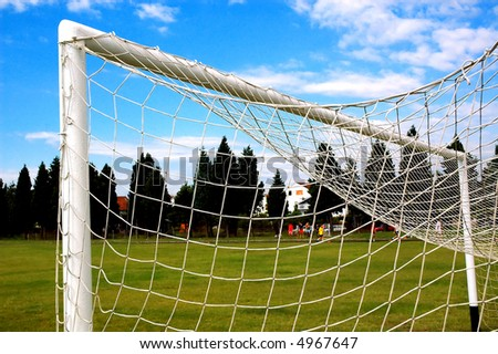 Soccer gate with nice clouds in background. - stock photo