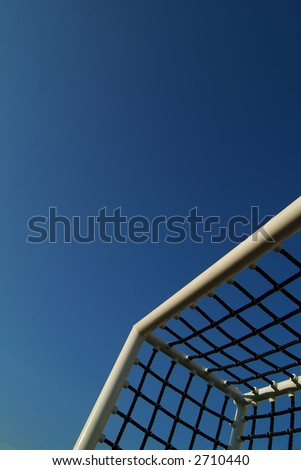 soccer goal against blue sky - stock photo
