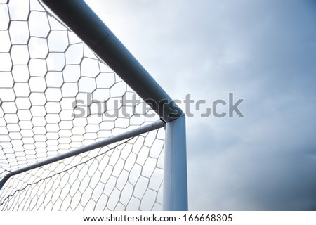 soccer goal against cloudy sky background.  - stock photo