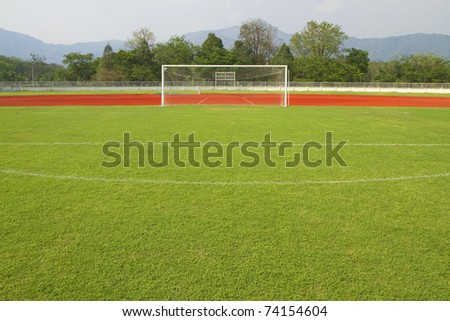 soccer goal,Green football field. - stock photo