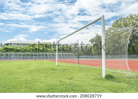 soccer goal in field with blue sky white cloud - stock photo