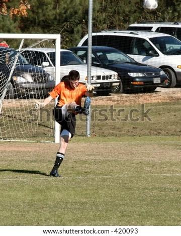 Soccer Goal Keeper punts - stock photo