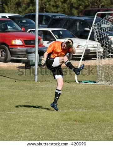 Soccer Goal Keeper punts the ball - stock photo