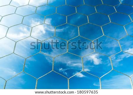 Soccer goal net on blue sky - stock photo