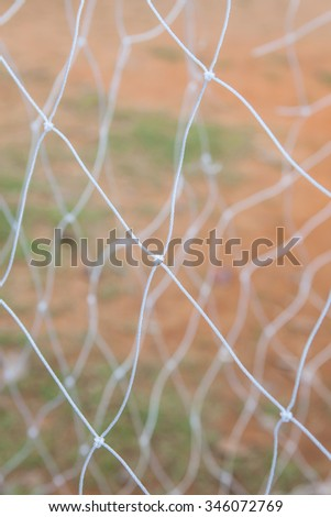 Soccer goal net on blurred background in shool at Thailand. - stock photo