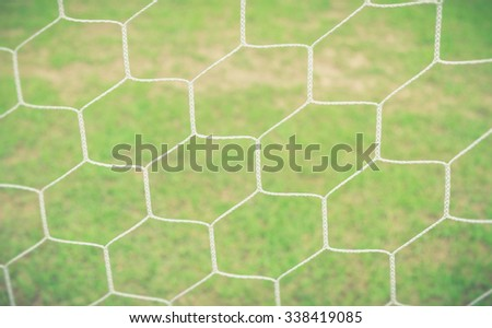 Soccer goal net on blurred background - Vintage effect style pictures - stock photo