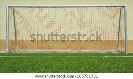 Soccer goal on green grass - stock photo
