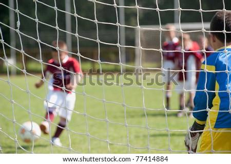 Soccer goalie in action - stock photo