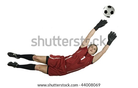 Soccer Goalie leaps for the ball to block - stock photo