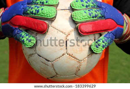 soccer goalkeeper catching  ball with hands - stock photo