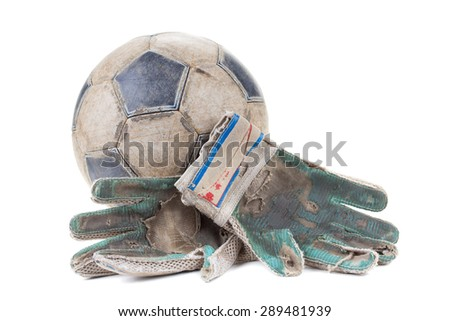 Soccer goalkeeper's gloves and the ball isolated on white background - stock photo