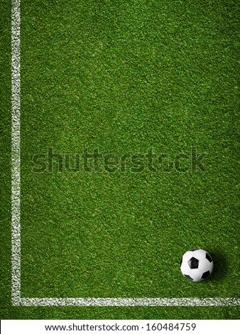 Soccer grass field with marking and ball top view - stock photo