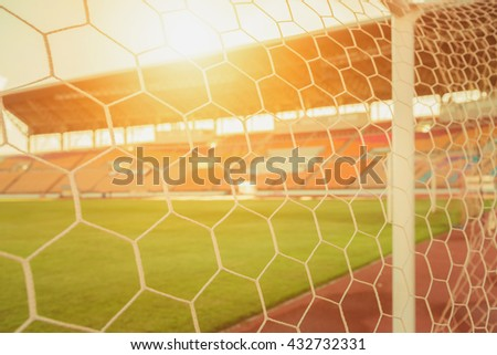 soccer net  at soccer stadium , vintage tone. - stock photo