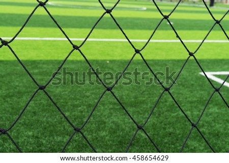 soccer net on green grass - stock photo