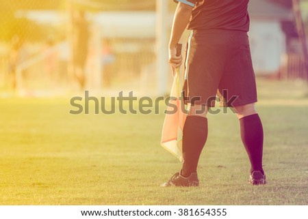 soccer or football assistant referee , vintage tone - stock photo