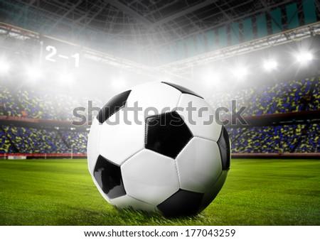 soccer or football ball on stadium - stock photo