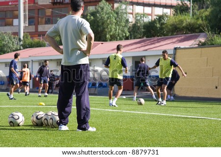 Soccer or football coach on a training session