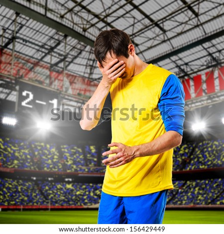 soccer or football player are celebrating goal on stadium - stock photo